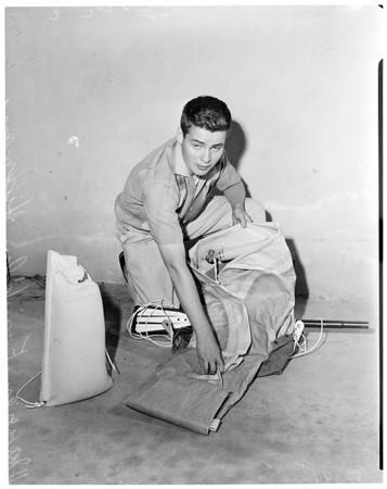 Boy balloon builder, 1957