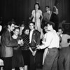 Teenagers of Club Co-ed enjoy dancing as the band plays in the background, 1946