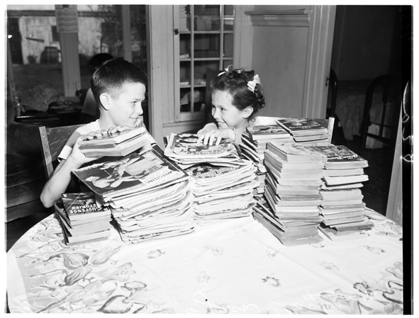 Brother and sister collect books for 40th Division, 1952