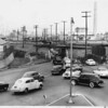 Traffic at Washington Blvd. & 23rd St. at underpass beneath railroad, Los Angeles, 1957