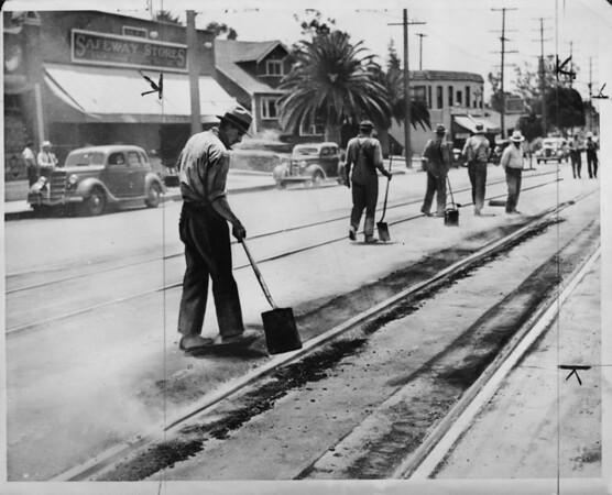 City workers paving around streetcar tracks, Los Angeles, 1936