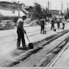 City workers paving around streetcar tracks, Los Angeles, 1936