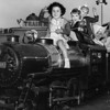 Los Angeles Orphanage children with Sister Catherine ride the miniature train at Nu-Pike, 1950
