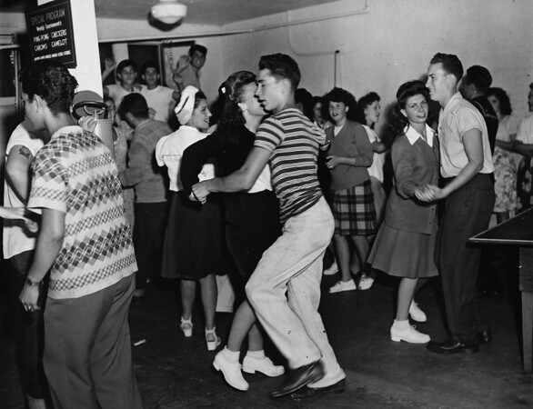 Members of the Boy's Club Canteen and their guests enjoy dancing, 1945