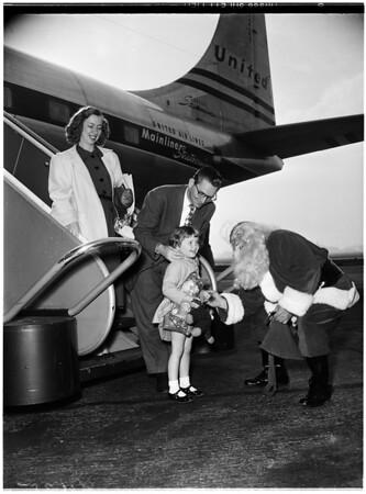 Christmas ...Santa Greets Travelers at International Airport, 1951