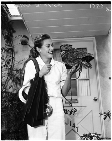 Skin diver and owl, 1958