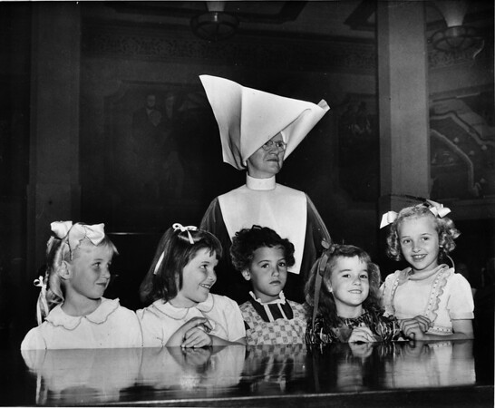 Los Angeles Orphanage girls with Sister Monica in front of the County Supervisors as Orphanage Month is approved, 1950