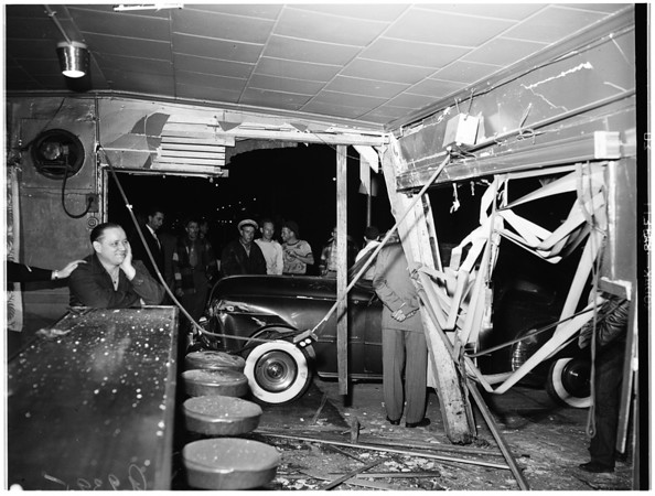 Freak crash... auto drives into bar and wrecks it, 1951