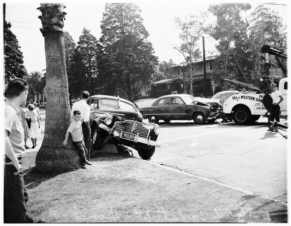 Auto accident at 6th Street and Harvard Boulevard, 1951