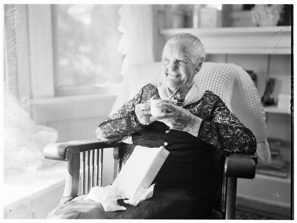 106th birthday...March 22...with Bible in lap and drinking coffee from 65-year old cup, 1952