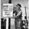 City Employee Alex C. Fry puts up a new right turn traffic sign, 1946