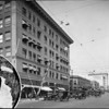A railroad crossing in front of the Security National Bank building, 1924