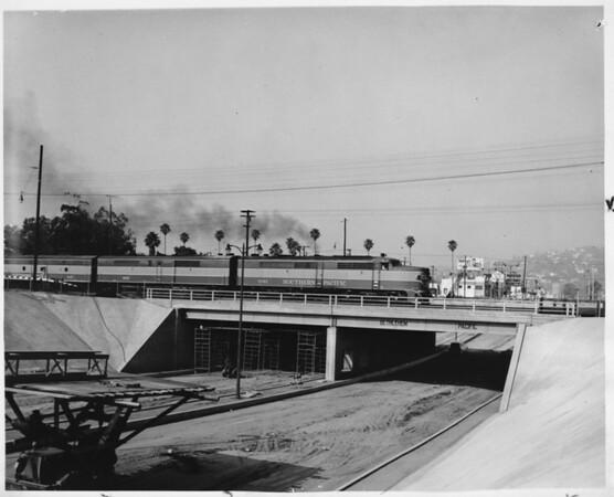 Los Feliz Blvd. bridge allows trains to pass without interrupting auto traffic, Los Angeles, 1957