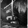 Runaway parked car lands on lawn of 1208 Hilldale Avenue, after it smashed into light pole, 1952