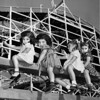 Four little girls from the Los Angeles Orphanage look over the fun zone of the Nu-Pike, 1950