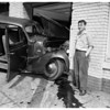 Car crashes into garage, 1951