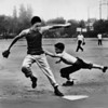 In a sandlot baseball game the first baseman tags a runner out, 1946