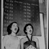 Two students practice vocal gymnastics at the Pasadena Playhouse Theater, 1952
