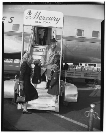 Pianist greeted by wife and two children on arrival at the Los Angeles International Airport, 1951