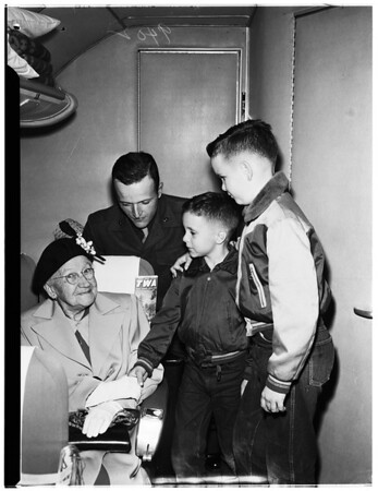 Thanksgiving trip...ninety-two-year-old grandmother takes first flight via Transcontinental and Western Airlines to visit family in Glendale, 1951