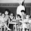College students from Mount Saint Mary's majoring in social welfare visit the Los Angeles Catholic Orphanage during a class session, 1955