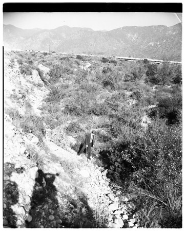 Body of woman in brush in San Gabriel wash showing Foothill Boulevard, 1958