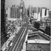 Birdseye view of the intersection of Broadway and Olympic Boulevard, Broadway faces north-east towards downtown, ca.1957