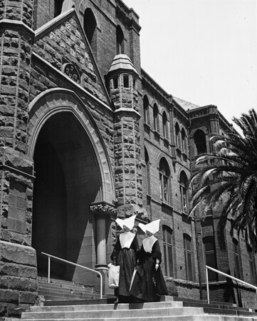 Two nuns on front steps of Los Angeles Orphanage, 1950