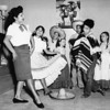 Maria Reyes performs the Mexico hat dance for a group of children, [s.d.]