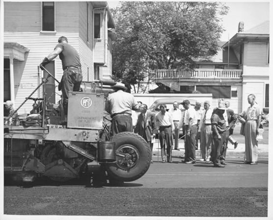 Rubber road installation along Figueroa St., Los Angeles, 1952