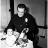 Baby saved from suffocation by Police officers, 1958