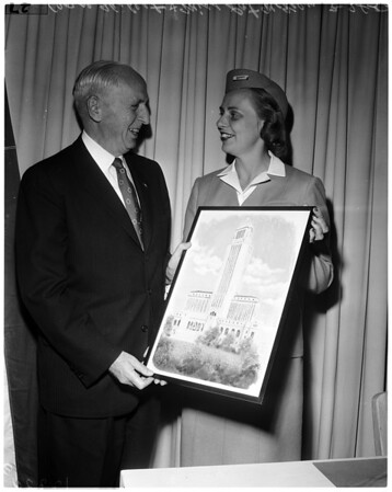 """""""Flying Secretary"""" presents original painting of City Hall to Los Angeles (Goodwill tour), 1958"""