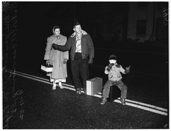 """Police take hitchhikers to Los Angeles by """"Shuttle Service"""", 1952."""
