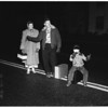 "Police take hitchhikers to Los Angeles by ""Shuttle Service"", 1952."