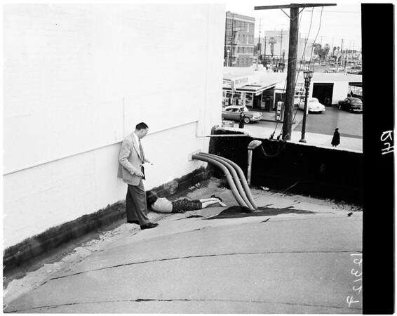 Suicide victim (jumped from Mode-O-Day building), 1958