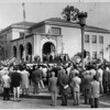 A crowd of people pledge allegiance to the flag at the dedication of Pasadena's County Court House, 1954