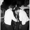 Taxi driver trapped in cab after hit and run wreck, 1951