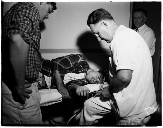 Boy hurt at Belmont High School playing football, 1951