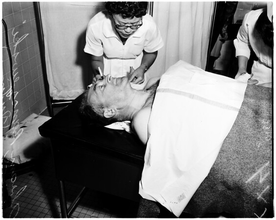 Shooting victim at Central Receiving Hospital, 1958