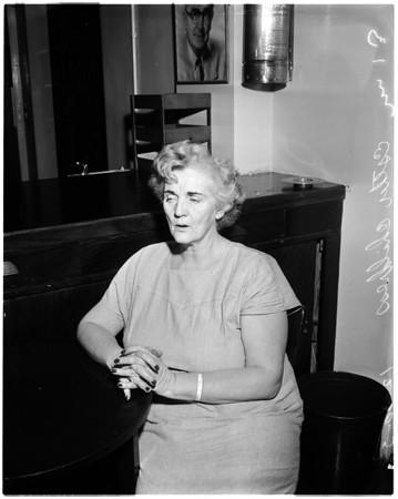 Suspicion of stabbing her husband, 1957