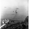 "Fishing boat, ""Benita"" on rocks at Point Fermin, San Diego... All aboard got off safely on Coast Guard cutter, 1952"