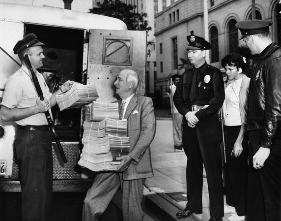 "C.A. Owen, head of ""Citizens Committee to Save Chavez Ravine for the People,"" gets petitions from armored car driver"