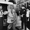"""C.A. Owen, head of """"Citizens Committee to Save Chavez Ravine for the People,"""" gets petitions from armored car driver"""