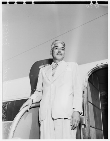 Japanese newspaperman arrives at airport, 1951
