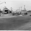 Washington Boulevard, heading east as it passes under a railroad line, Los Angeles, 1953