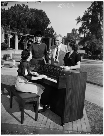 Los Angeles Crippled Children's Society ...Lawry's, Richlor's, and Steers' restaurant workers present society with piano for handicapped youngsters, 1951