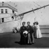 "Mrs. Anna M. Averil and Madame Caroline M. Severance standing in front of the ""ship"" Cabrillo at the Venice Amusement Pier in Venice, California, ca.1910"