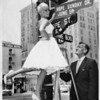 Hope Holiday & Arch Field change Hope Street sign, Los Angeles, 1960