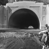 Sepulveda Tunnel portal photograph retouched to include Gypsy women in foreground, 1930