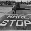 "White letters four feet high ""advertise"" spelling error on street, Los Angeles, 1949"